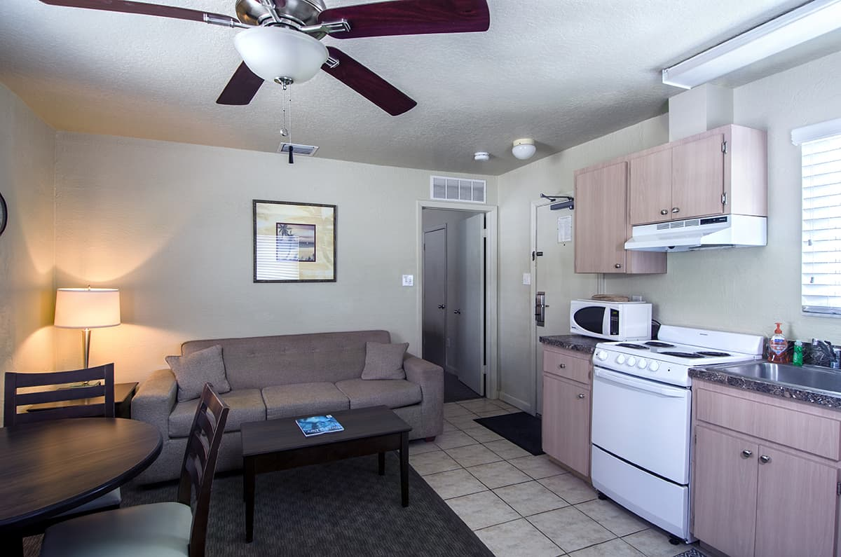 This Two-Room Suite (Apartment) Features a Living Room/Dining Area and a Bedroom with 2 Double Beds